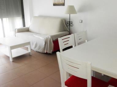 salon-comedor_2-apartamento-2-dormitorios-(4-6-personas)-alcocebre-suites-hotel-.jpg