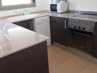 cocina_2-apartamento-3-dormitorios-(6-8-personas)-alcocebre-suites-hotel-.jpg